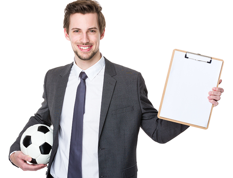 Football manager hold with soccer and clipboard